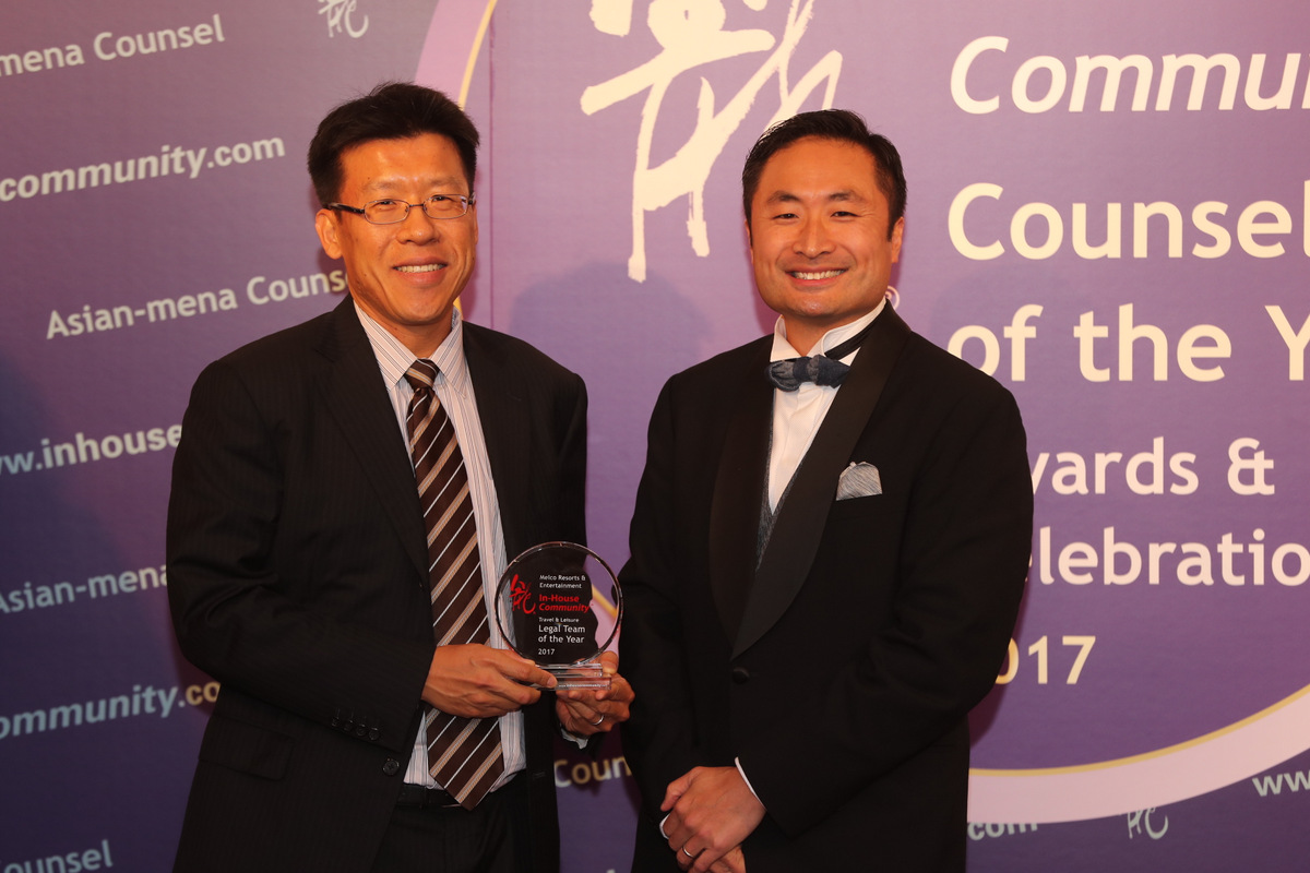 Travel & Leisure Winner: Melco Resorts & Entertainment – Tim Sung of Melco collects the award from Stanley Lui of Hilti Asia