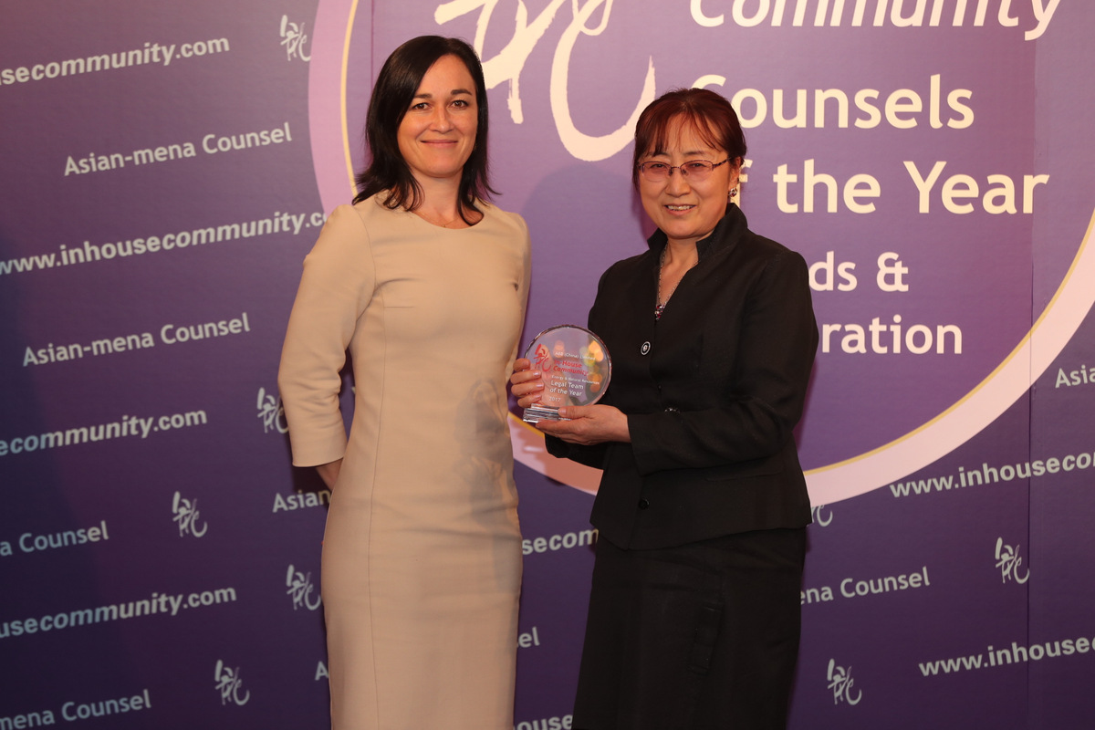 Energy & Natural Resources Winner: ABB (China) – Fengwen Jiang (right) of ABB China collects the award