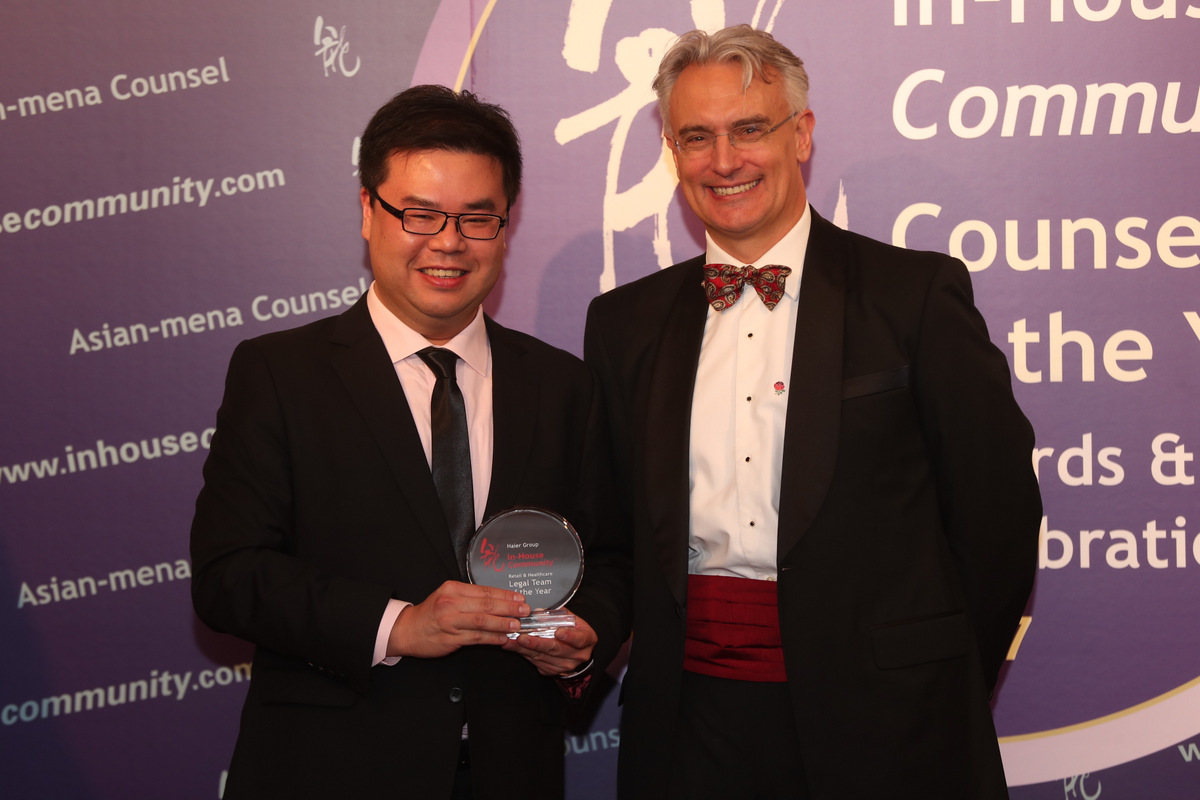 Retail & Healthcare Winner: Haier Group – Ricky Lioe of King & Wood Mallesons receives the award on behalf of Haier Group